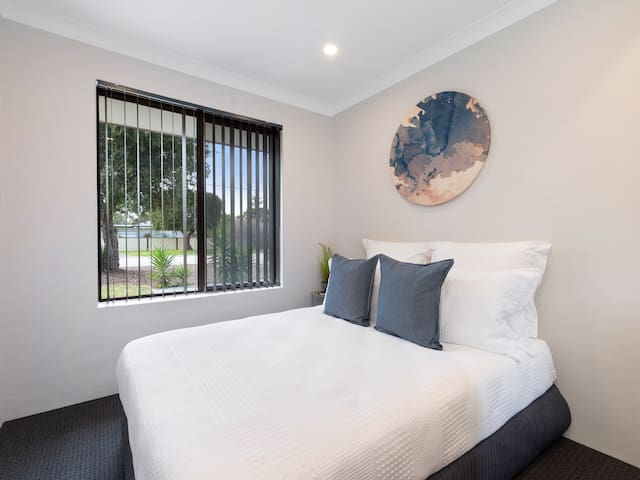 Double bed with garden views and plenty of extra pillows / warm quilts and blankets for yourself or extra guests.