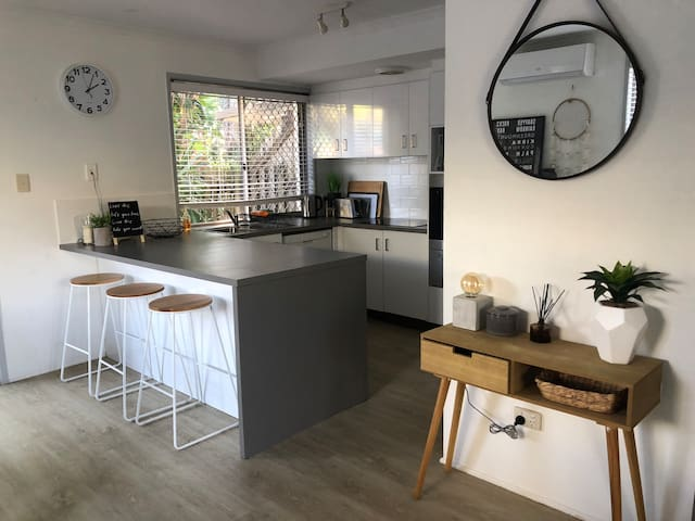 Kitchen / Diner - Homely & Social hub - Recently renovated kitchen with all amenities and fully loaded with everything required for a the perfect family holiday.  Overlooking the backyard and breakfast bar seats 3 people.
