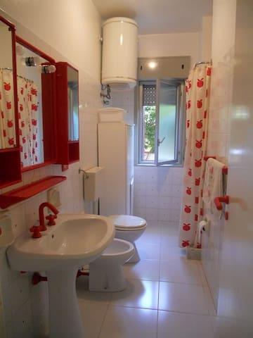 Bathroom with box shower