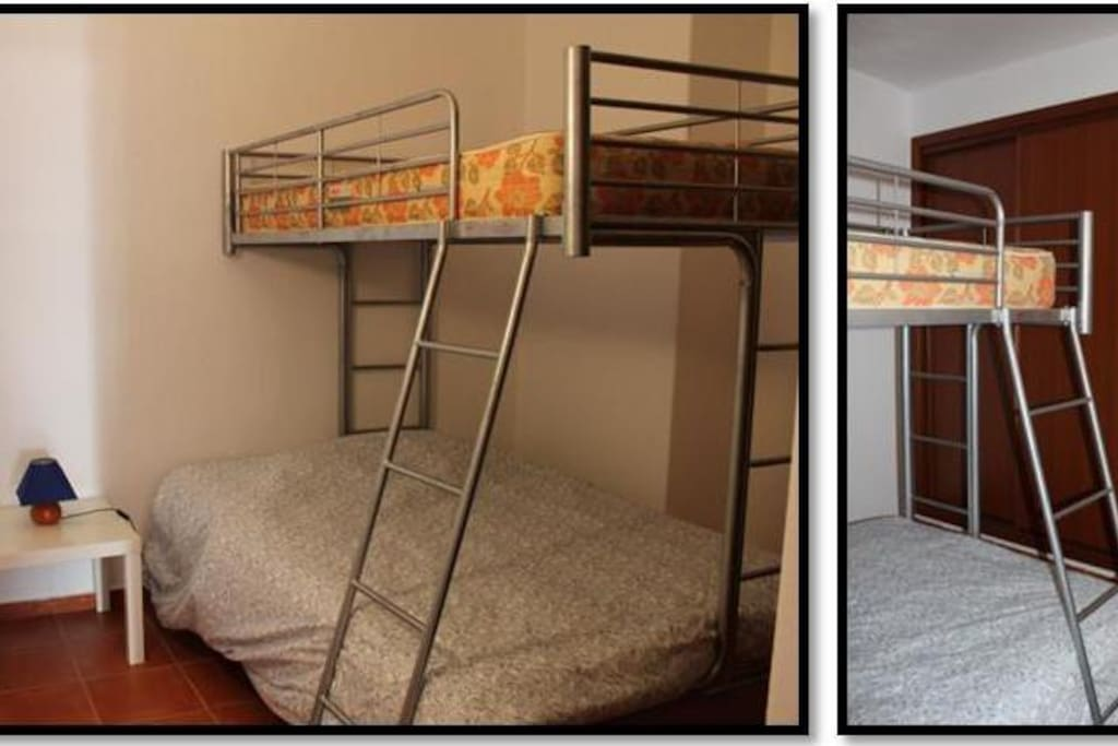 Bedroom with bunk bed that has a double bed below and a single bed upstairs