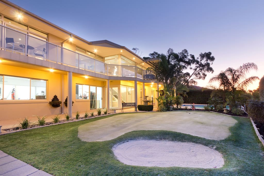Set in tropical garden with golf putting green and bunker