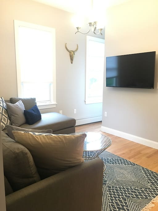 The living room features a brand-new Smart TV that comes pre-loaded with apps like Netflix.