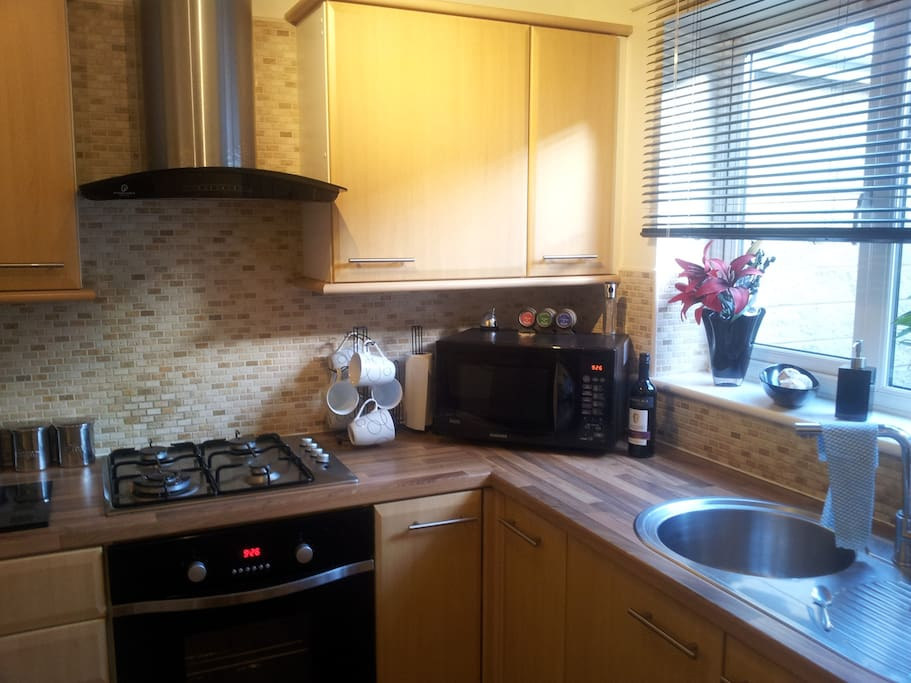 Modern kitchen with most amenities, plus round glass table with 4 chairs ( not shown)