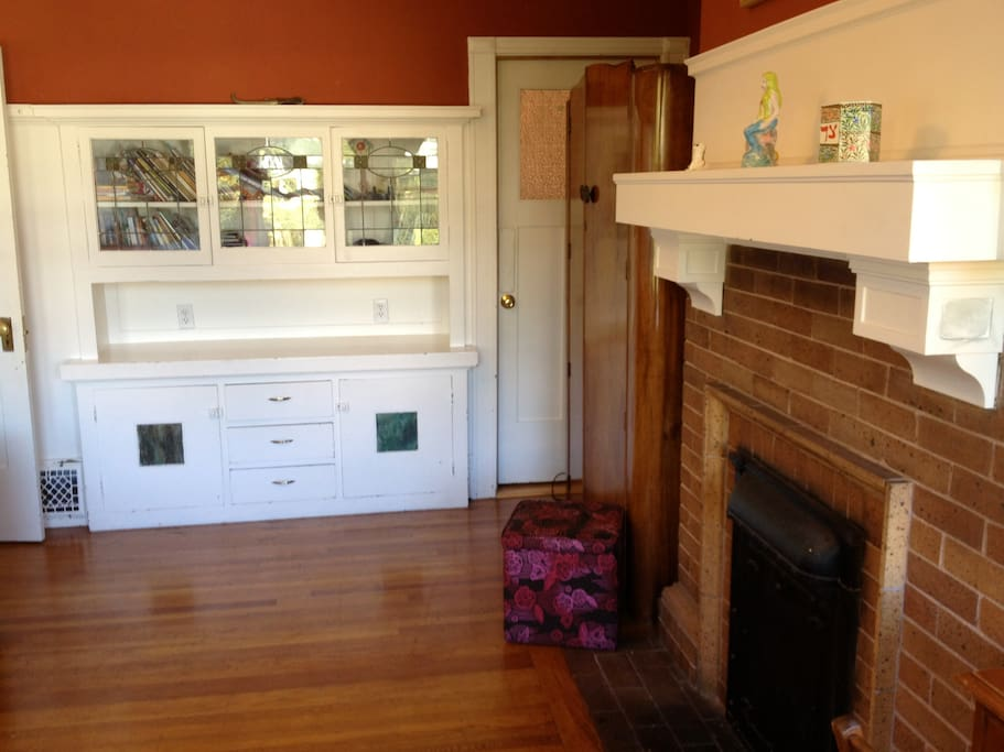Here you can see the armoire, fireplace and built-in dresser/bookcase with leaded glass.