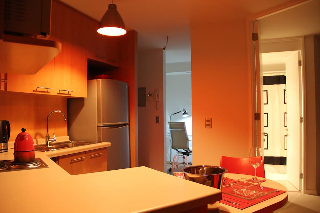 Apartment 2 Blocks Metro - Kitchen and view of the office room (Left) and bathroom (Right)