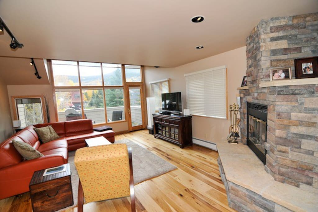 Spacious living area with state of the art TV and entertainment system.