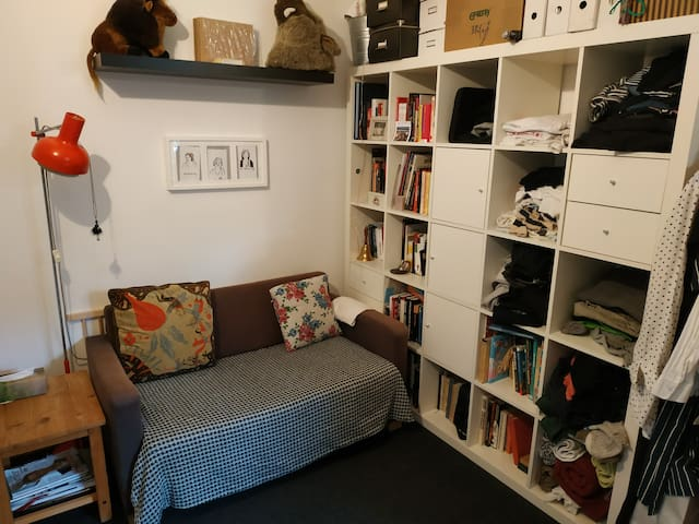 Living rooom. There will be some space for your stuff as well.