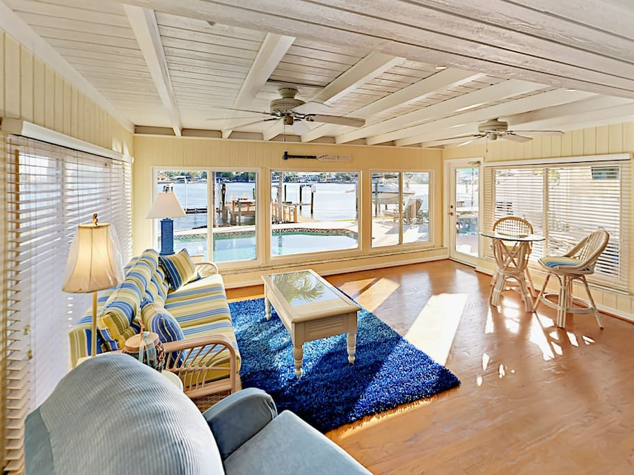 Large bay windows in the sunroom offer amazing waterfront views.