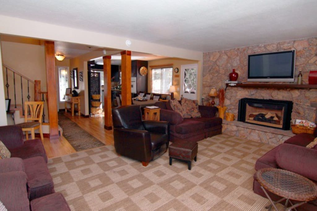 Lodge Living,  4 sofas, club chair, gas fireplace and flat screen