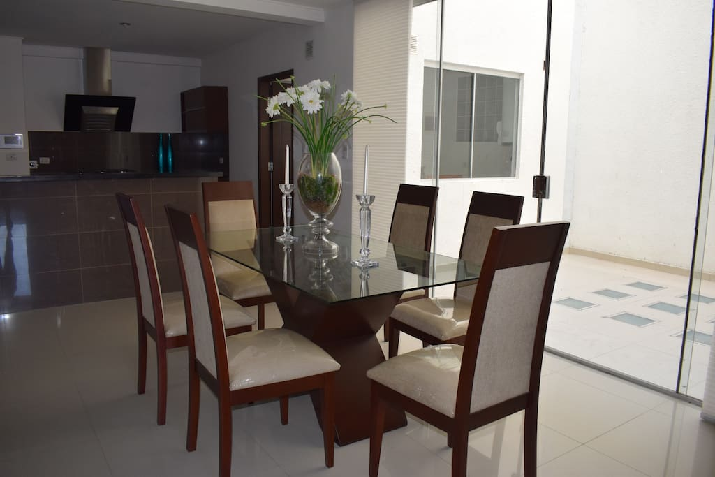 Dining area. On the immediate right-hand-side there is a small patio.