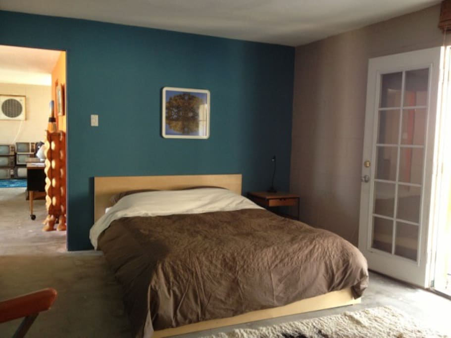 blue bedroom with french doors to back patio