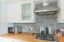 Kitchen with fan oven, gas hob and microwave