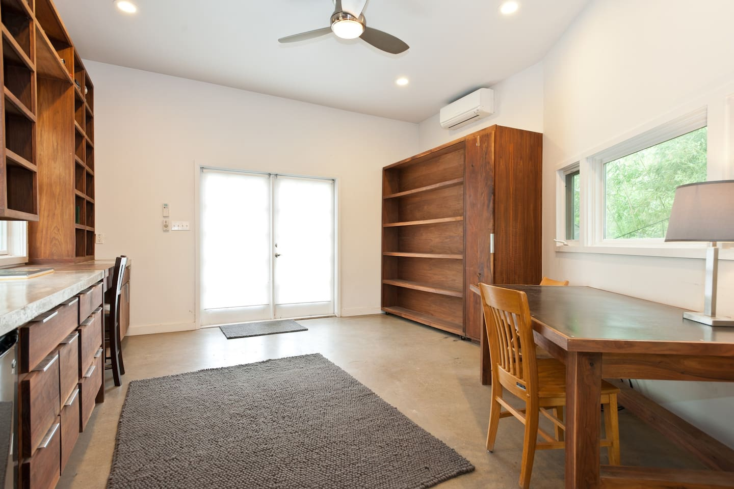 What's that big shelf in the back, you ask? Why, it's a fold-down Murphy bed. Scroll through more photos to see it in action.