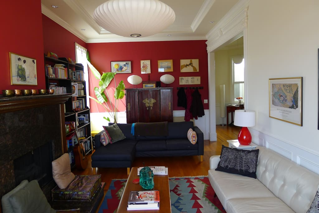 Sunny living room with extensive library
