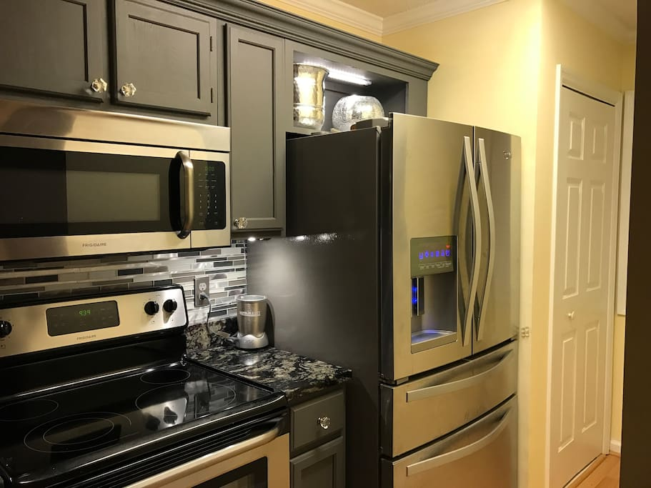 All stainless steel appliances, under counter lighting, microwave, quiet dishwasher, self cleaning oven, French door style refrigerator, K-cup coffeemaker, and well appointed cooking utensils & dishes.