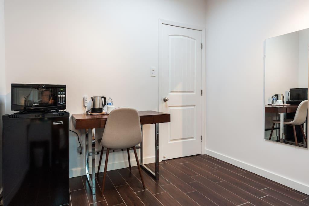Microwave, refrigerator, mirror, working desk, chair.