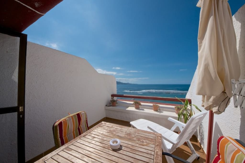 views from the sun terrace with table, seats and sun lounger