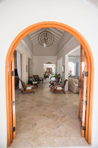 Main Entryway into villa showing open  vaulted ceiling