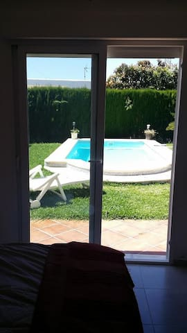 The double room off the garden and pool