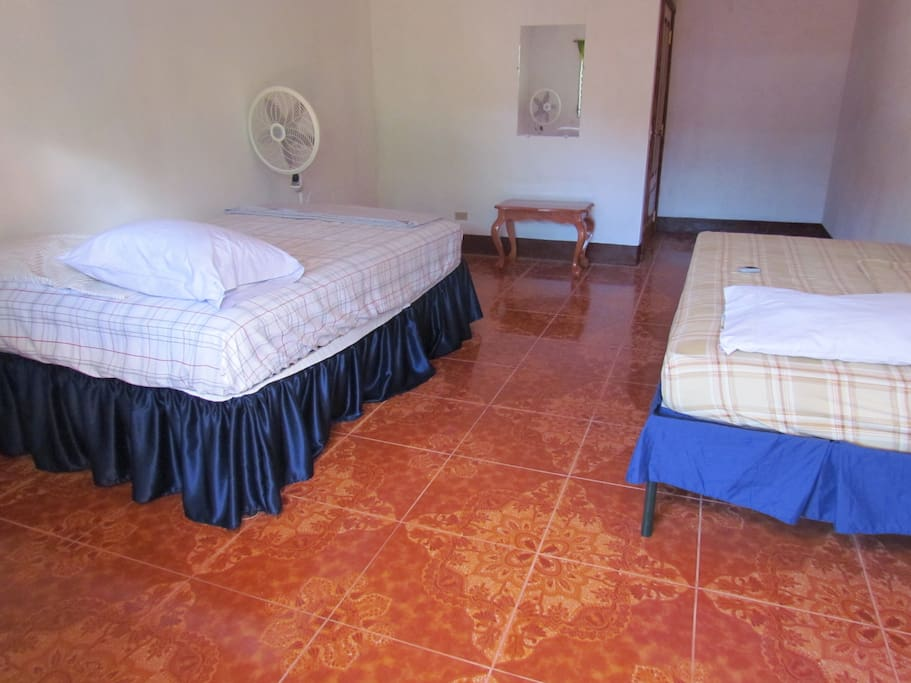one single and one double beds also with the ceramic tails on the floor.