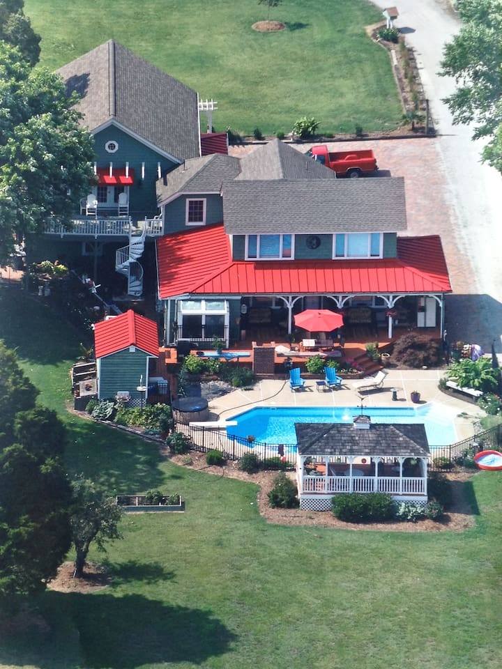 The original house in the center of the picturewas built in 1878. We did the addition where guests will be staying in 2008. The upper deck can be seen on the left. Guests will have pool privilages.