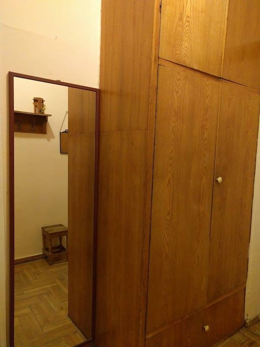 entrance featuring mirror and large closet-storage.