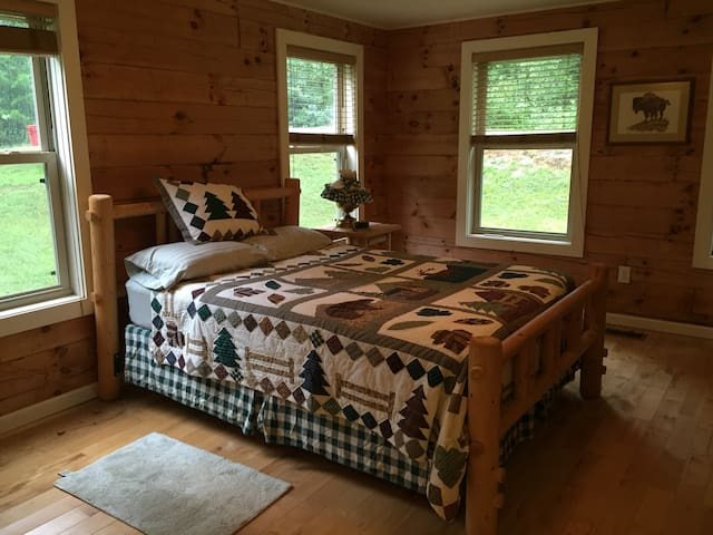 Master Bedroom with Queen size bed and private full Bathroom