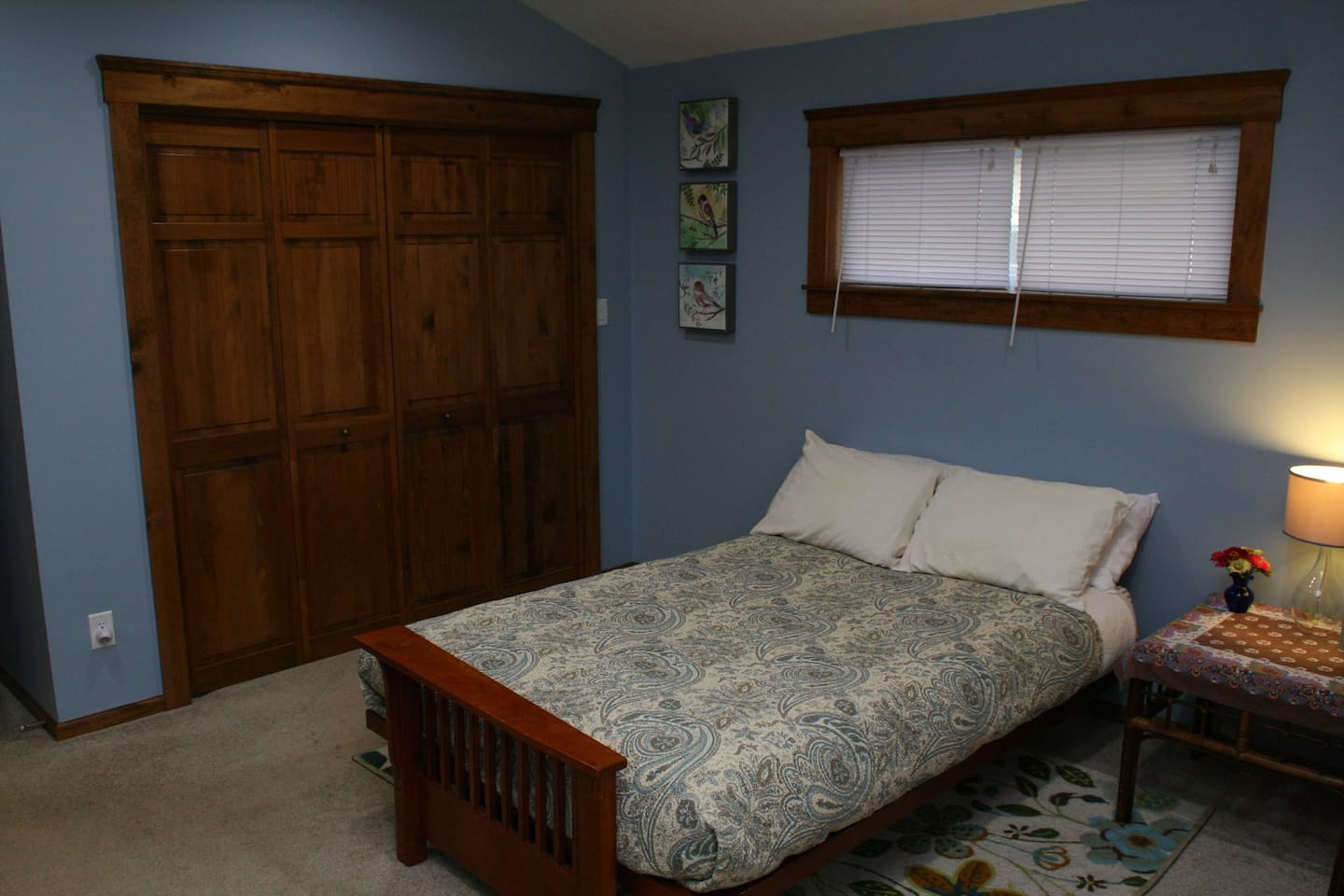Your very spacious bedroom has a comfy futon mattress with a side table and lamp. The closet has hangers, an iron and ironing board, and a hanging organizer.