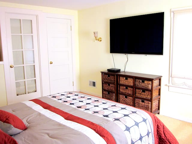 55 inch plasma TV in bedroom.