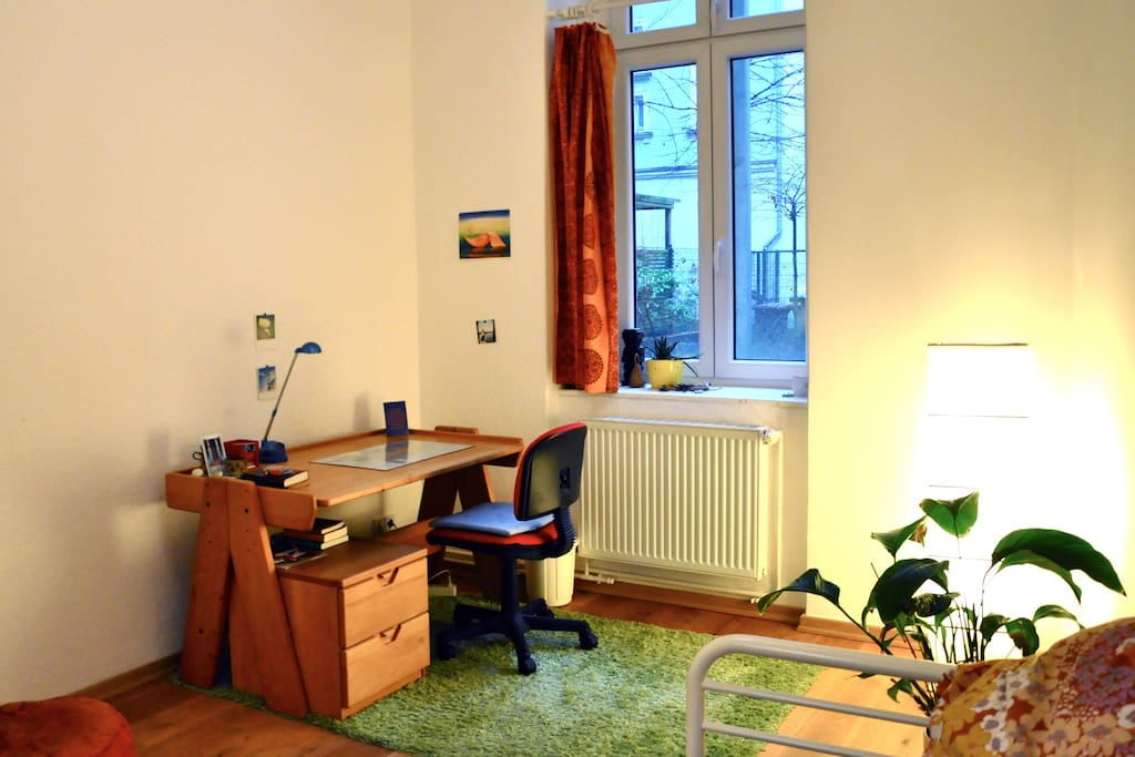 cozy room with spacious wooden desk