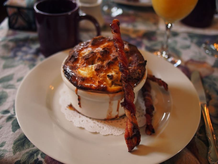 Cinnamon Apple French Toast Souffle' with twisty bacon