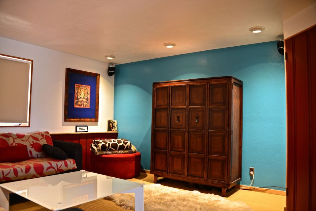 TV Room with L-shaped Couch, 52 inch Flat Screen TV, DVD player, Stereo