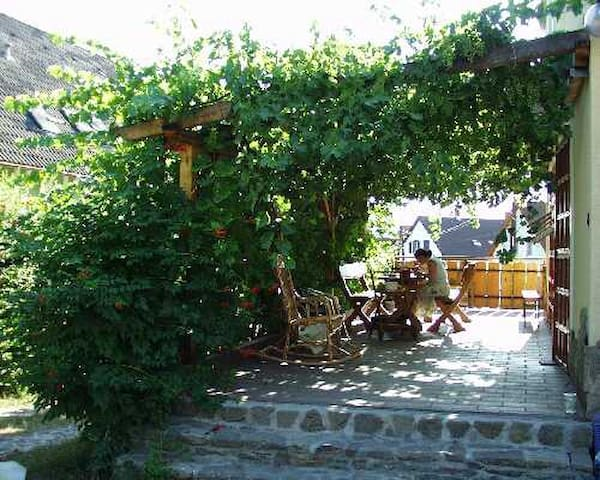 Grape Arbor  Thatched apartment