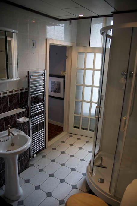 a lovely large luxury ensuite bathroom