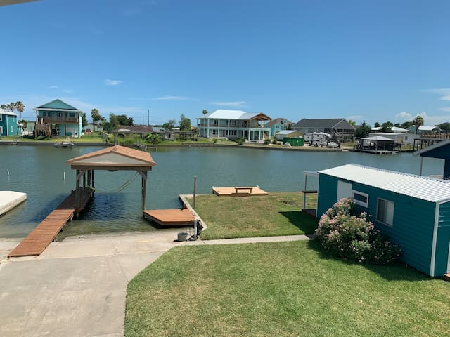 View from 2nd floor balcony of canal, boat slip and boat ramp. Boat ramp available for use.