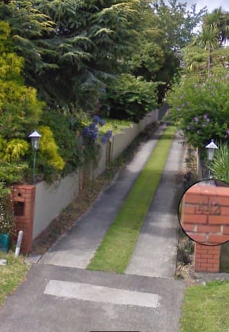 Red brick pillar driveway will lead to our home and inside we have plenty of parking space