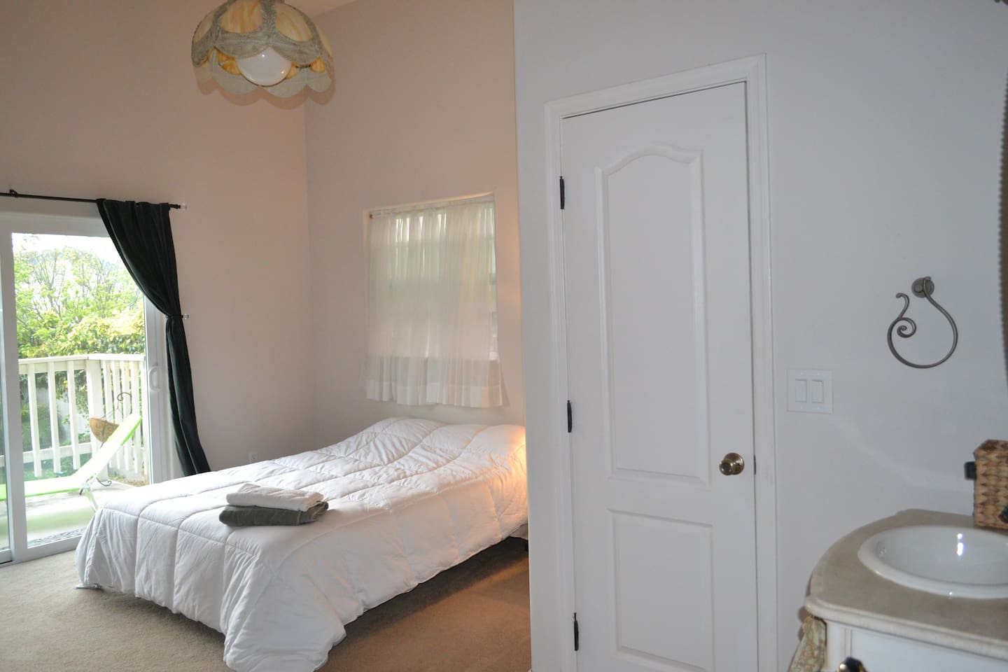 Master bedroom, Queen bed, Private entrance and your own restroom.  You can also see a bit of the ocean from here.