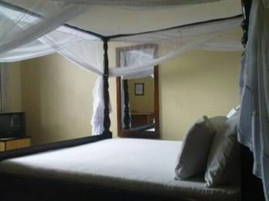 A bedroom with a double bed