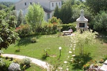 lovely garden with stone barbecue