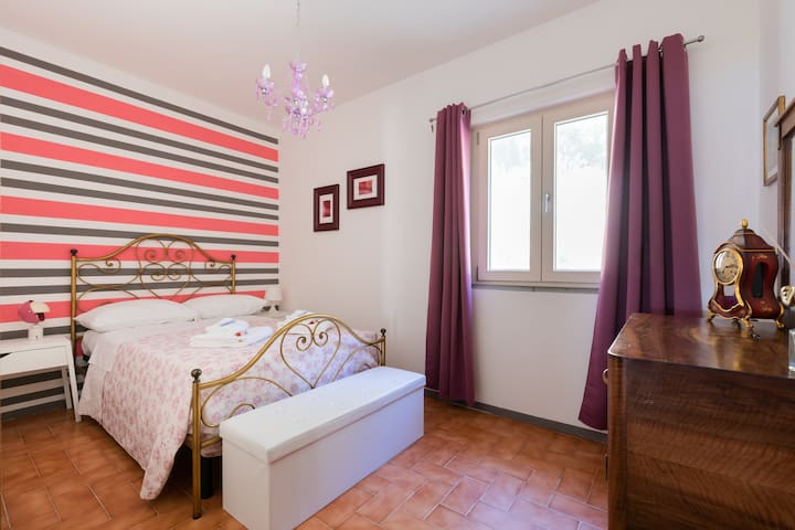 The Pink Room, with one queen size bed for one or two people