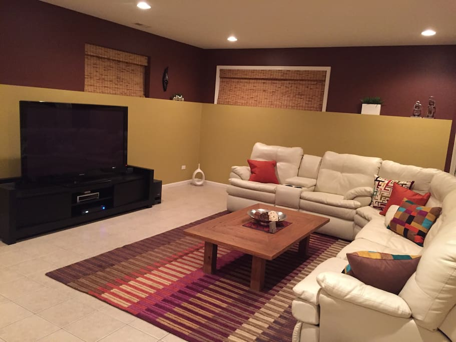 Reclining couches with 65 inch HDTV and Bose surround sound system. Comcast cable tv with upgraded package available.