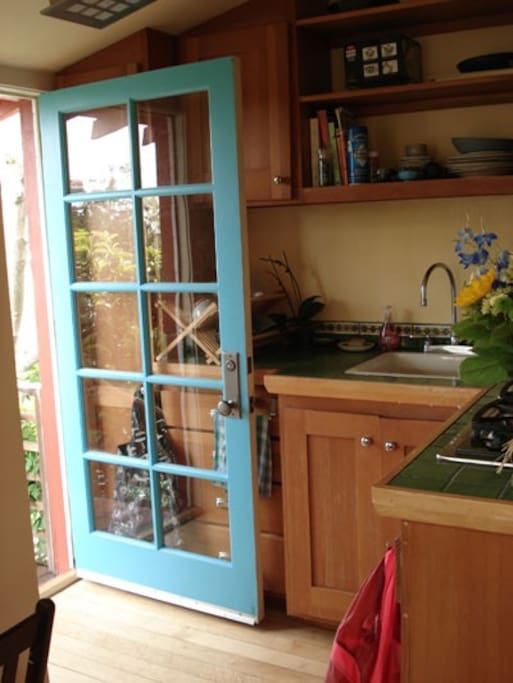 kitchen with gas stove and refrigerator below.