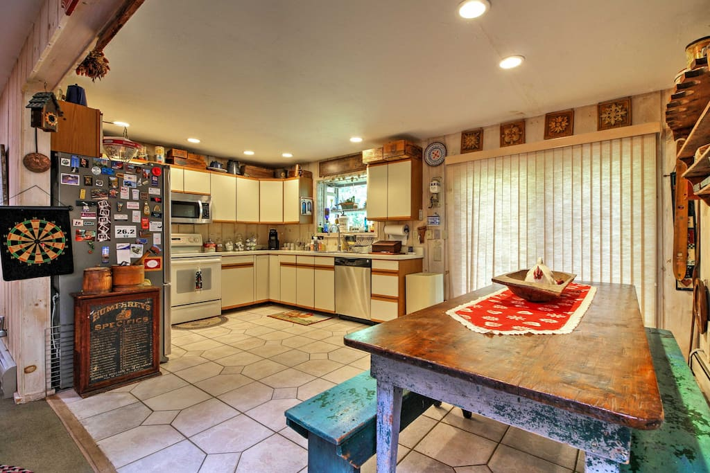 Everyone in your travel group can dine together at the antique table in the kitchen.