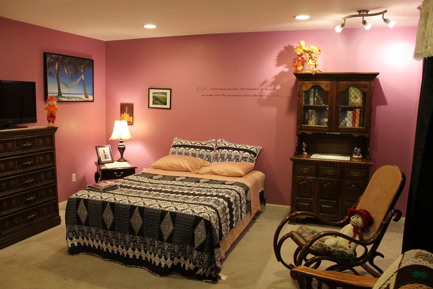 """Bdrm #1, 18'x15' w 5'x7' Walk-In Closet, Queen Bed, w 5-drw dresser, extra cabinet, large desk, 36"""" Cable TV, Recliner/Rocker and Rocking Chair."""