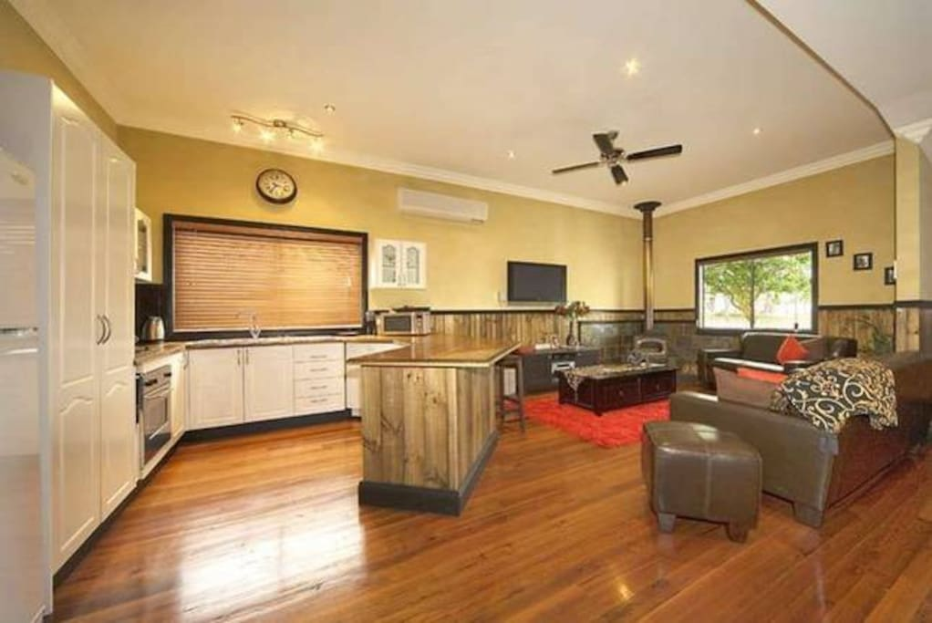 Full kitchen with dishwasher, microwave, gas cook top and electric oven