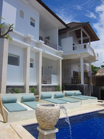 Swimming pool & Deck Chairs & building of rooms