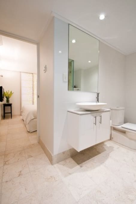 The bathroom is an ensuite for the bedroom, but it also has a second door so you (or your guests) can get to the bathroom without going through the bedroom.