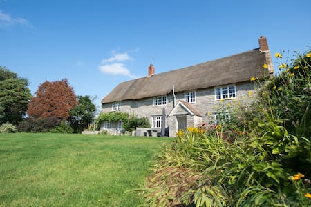 Farm House thatched in quiet hamlet of Somerset