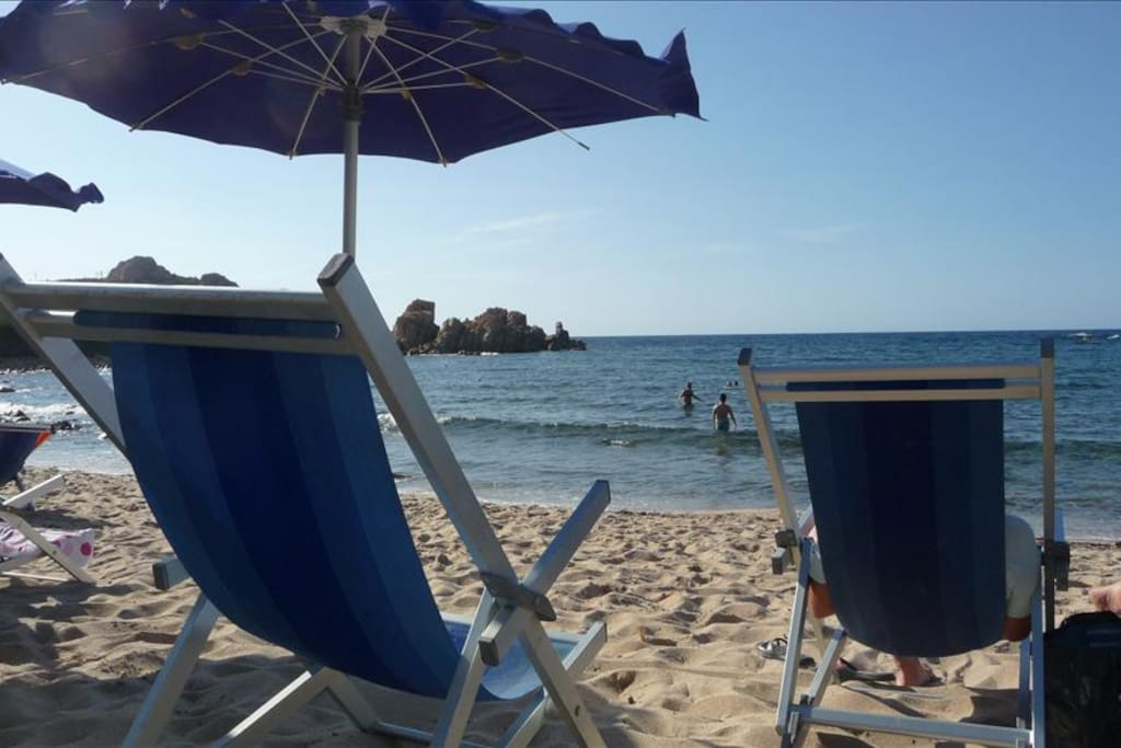 The Beach With Sun Loungers And Parasols For Hire