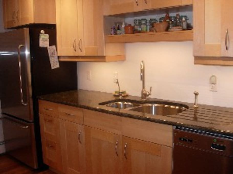 deep double sink, filtered water spigot, large fridge with pullout freezer, and dishwasher